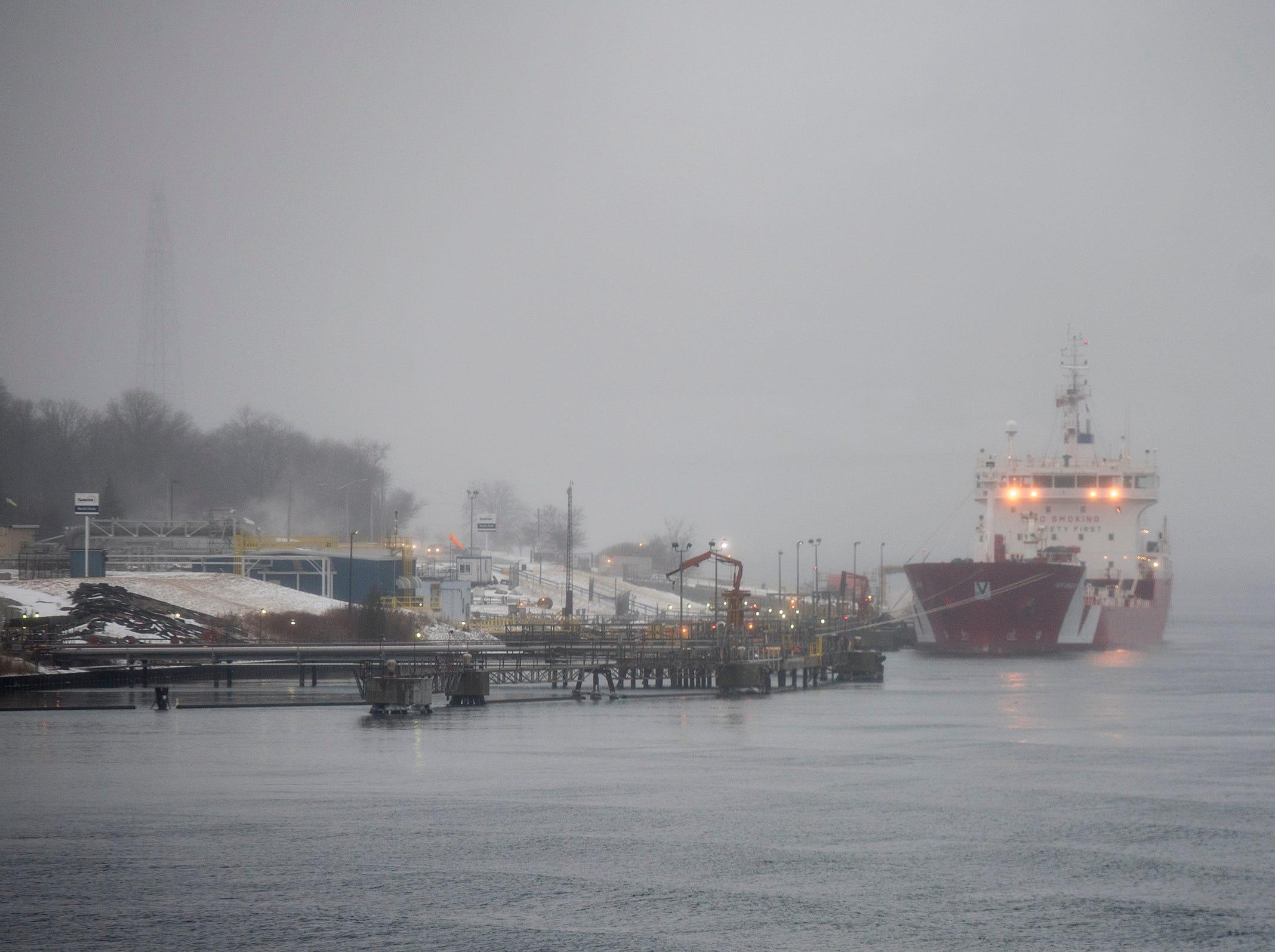 A freighter is seen through the fog docked near Sarnia, ON, Wednesday, Feb. 20, 2019.