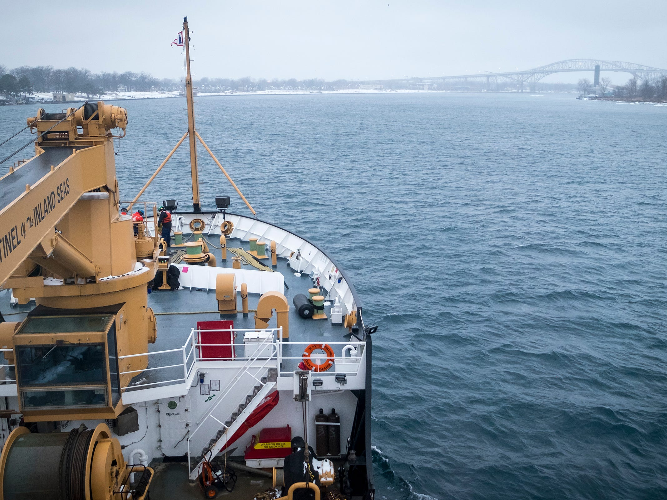 The Blue Water Bridge can be seen through the fog off the starboard bow of the USCGC Hollyhock as it nears home Wednesday, Feb. 20, 2019 on the St. Clair River in Port Huron. Shortly after escorting the Algonova through ice near Algonac, freezing rain and fog moved into the area, limiting the crew's visibility.