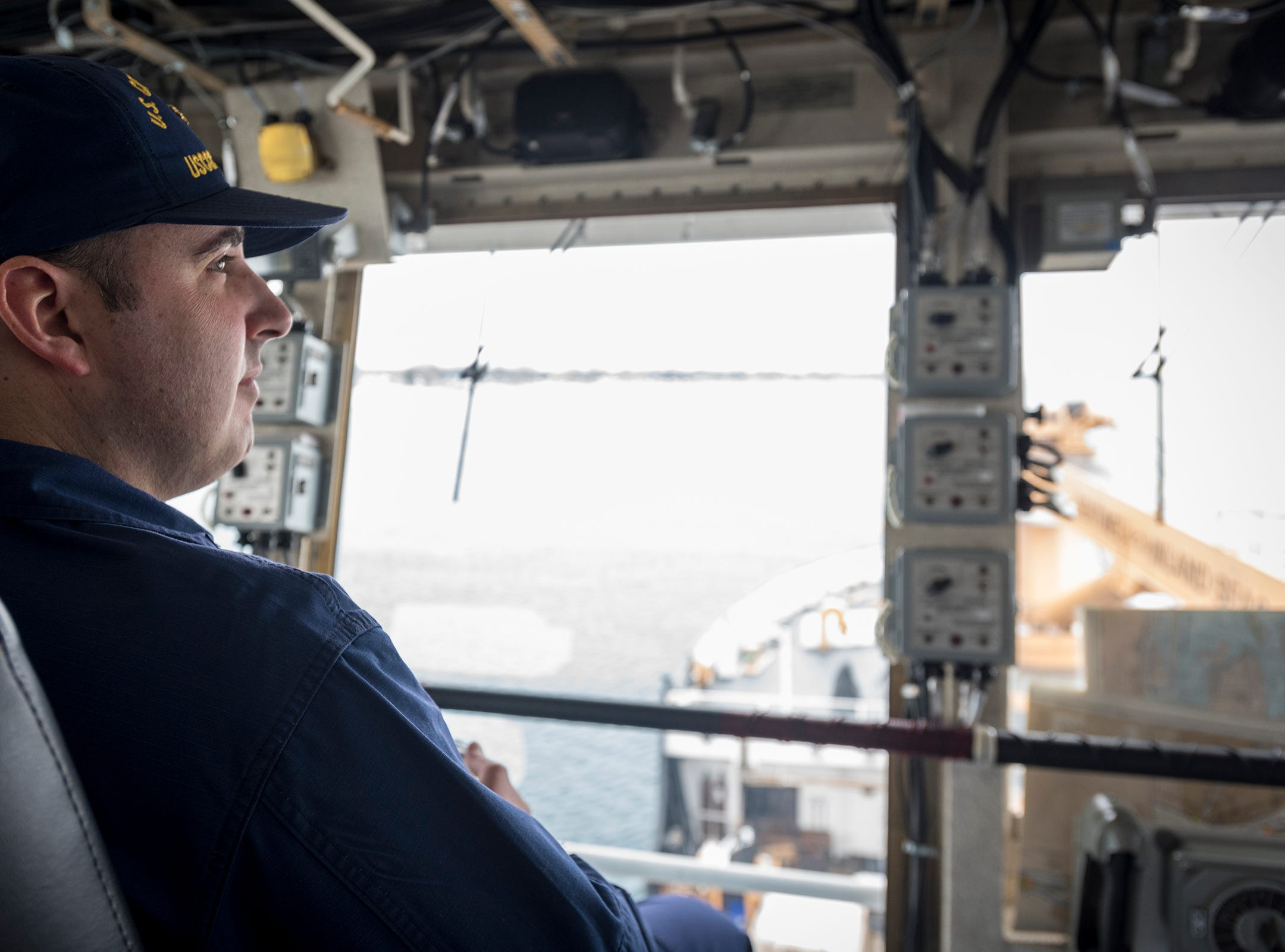 U.S. Coast Guard Lt. Cmdr. Nick Monacelli looks out over the deck of the USCGC Hollyhock as it is downbound Wednesday, Feb. 20, 2019 on the St. Clair River. Monacelli said this year has seen more icing in the area than last year. During the polar vortex, the surface of the river froze to a solid plate, and the river was closed. Ice breaking missions can only do so much, Monacelli said, and sometimes they would have to wait for the weather to change.