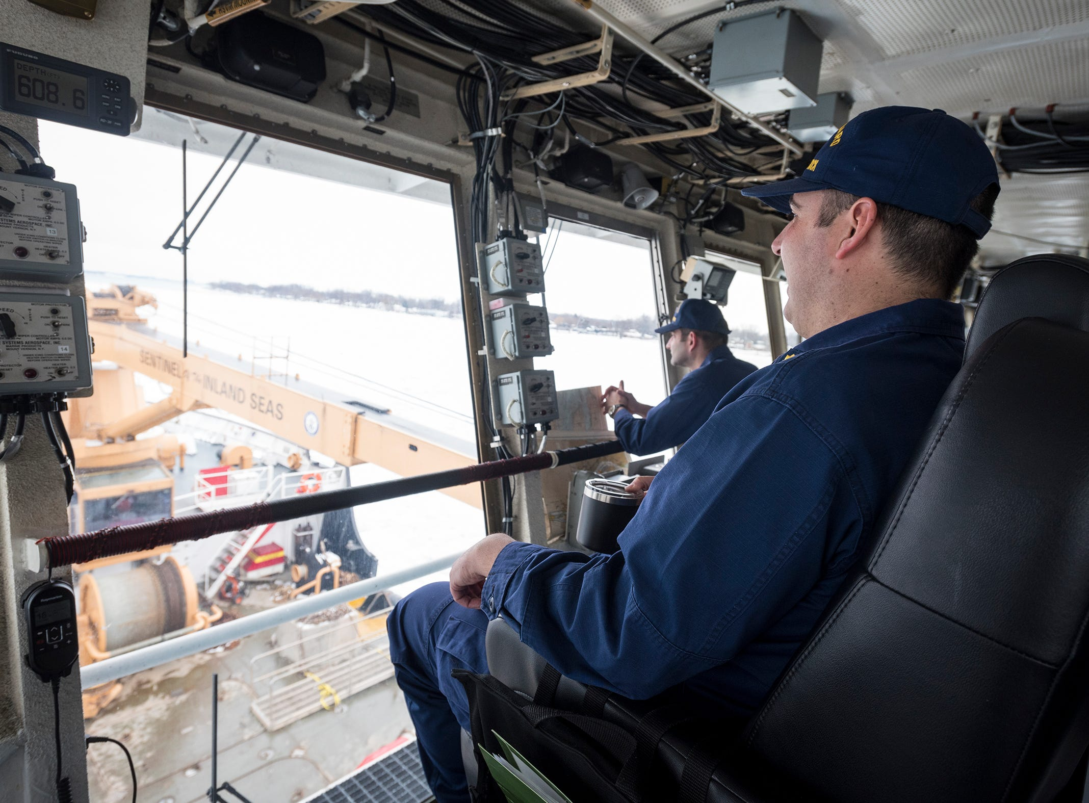 """U.S. Coast Guard Lt. Cmdr. Nick Monacelli looks out over the deck of the USCGC Hollyhock as it is downbound Wednesday, Feb. 20, 2019 on the St. Clair River. Wednesday's ice breaking mission was part of Operation Coal Shovel, a joint operation between the United States and Canada, to ensure the last freighters of the season can make it through the St. Clair-Detroit river system. """"The challenge is there's always traffic that wants to move,"""" Monacelli said. """"You always wish you had more assets that you could run 24/7."""""""