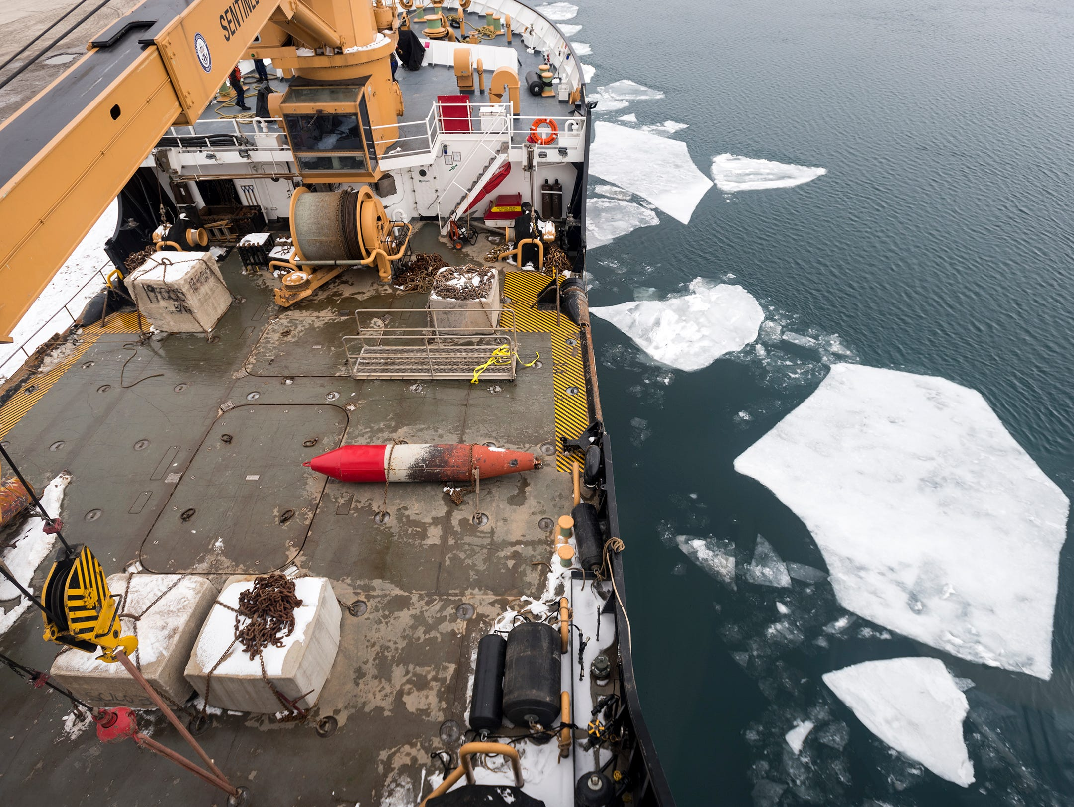 Chunks of ice float past the deck of the USCGC Hollyhock Wednesday morning, Feb. 20, 2019, before the ship is underway on the St. Clair River from the Cargill Salt plant in St. Clair. The day's mission is to head south on the river to meet up with the USCGC Bristol Bay to escort the Algonova, a nearly 430-foot freighter north, through an ice jam that had formed near Algonac.