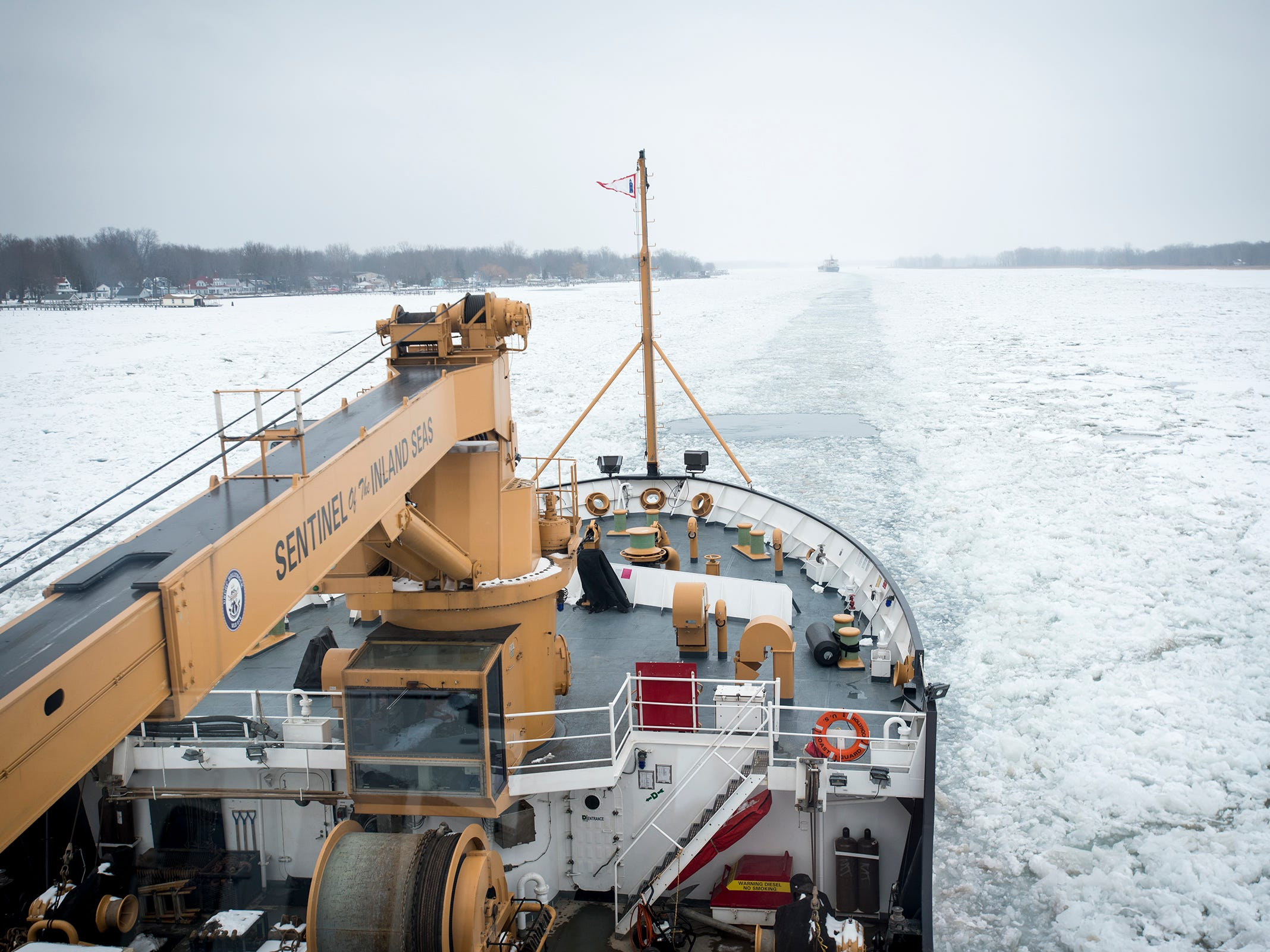 The USCGC Hollyhock follows the Algonova north on the St. Clair River Wednesday, Feb. 20, 2019, near Algonac. The Hollyhock, together with the USCGC Bristol Bay, escorted the nearly 430-foot freighter through an ice jam that had formed near Algonac.