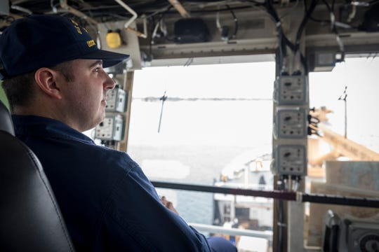 U.S. Coast Guard Lt. Cmdr. Nick Monacelli looks out over the deck of the USCGC Hollyhock as it is downbound Wednesday, Feb. 20, 2019 on the St. Clair River. Later, the ship would meet up with the USCGC Bristol Bay to escort the almost 430-foot long cargo freighter Algonova through an ice jam that had formed south of Algonac.