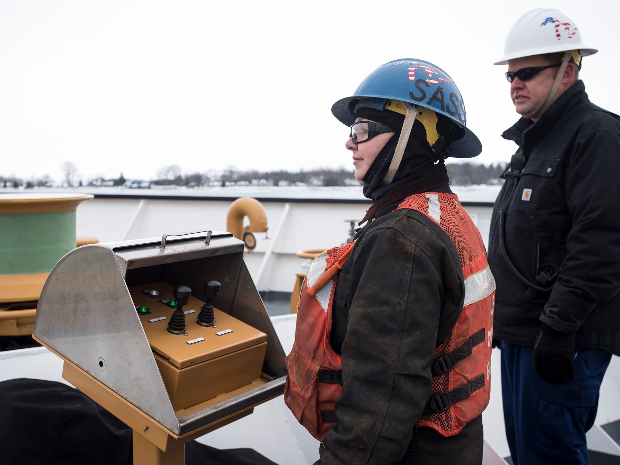 Seaman Christie Rosa, left, waits near a control panel with CW02 Adam Kane on the deck of the USCGC Hollyhock Wednesday, Feb. 20, 2019.
