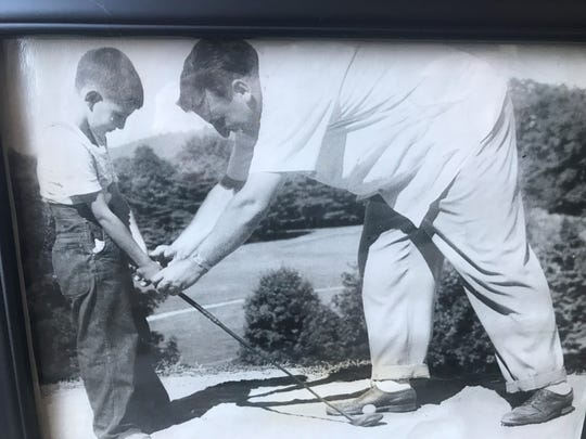 A young Ralph DeStefano is shown how to hold a golf club by his father, Charlie.