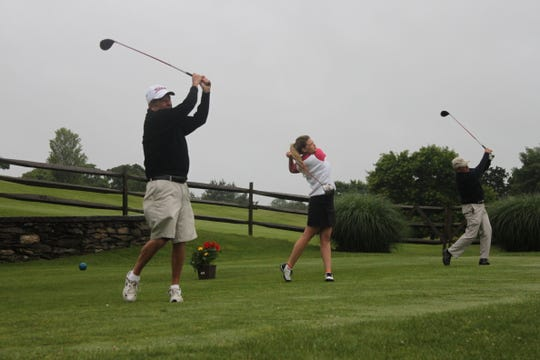 In this June 2, 2012 file photo, Ralph DeStefano, left, tees off with granddaughter Christina DeStefano and son Tony DeStefano, in a ceremony to officially start the 75th annual Ralph DeStefano Memorial golf tournament at College Hill Golf Course.