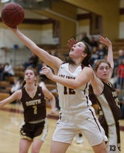 Arlington's Molly Stephens takes a shot after working her way around Clarkstown South's Megan Hackett during Thursday's game in Freedom Plains on February 21, 2019.