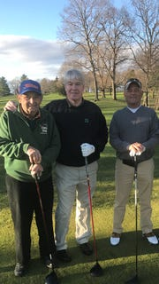 From left, Ralph DeStefano, Garth D. Bishop and Tony DeStefano pose together.