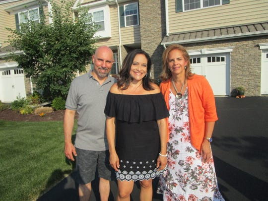As seen on HGTV's House Hunters, Rich Miro, left, and Rosa Miro, middle, are looking for a new home in or near Peekskill, NY, with the help of their realtor, Grace Patalano.
