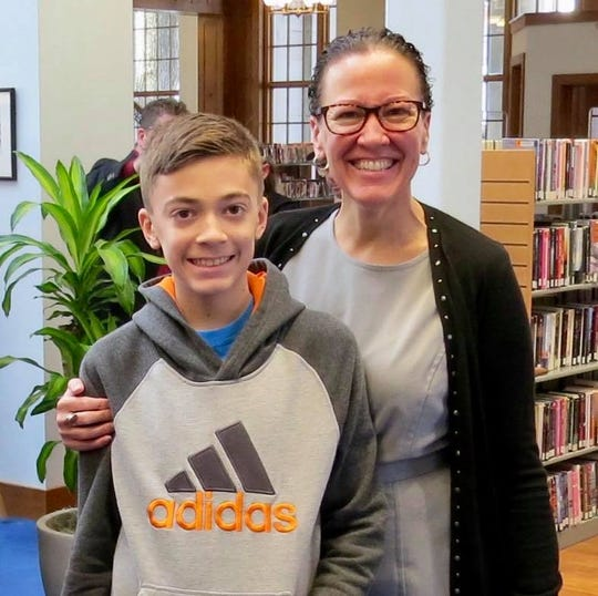 Kim Crider, Republican candidate for Franklin County Commissioner, and her son at Coyle Free Library.