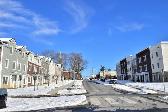 The Washington Square Townhomes and Apartments, pictured here on Thursday, Feb. 21, 2019, are in the boundary of the Elm Street Neighborhood Plan. Funding made available because of the plan was used to demolish an old County Market grocery store in 2016, to make room for the housing project which serves low- to moderate-income seniors and families.