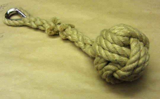 Known as a slungshot, monkey fist or monkey ball, this weapon is made by wrapping paracord or rope around a metal ball and attaching it to a braid of cord or rope.