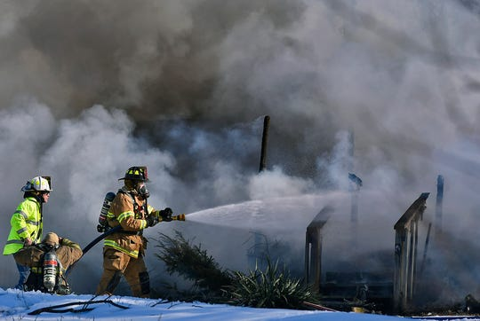 Firefighters battle a mobile-home blaze in Lower WindsorTownship, Thursday, February 21, 2019.A family of five were displaced.