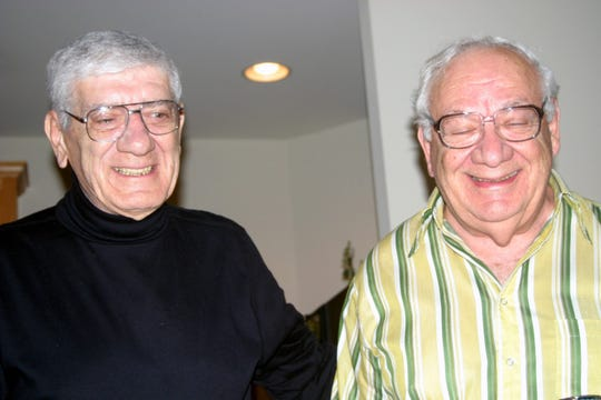 Dominick Argento, right shares a laugh with his brother, Joe, my dad, during a family gathering.