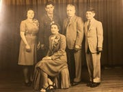 A family portrait: Dominick Argento, in his Army uniform, stood for this studio photo with his family. Standing, from the left, his sister Virginia, Dominick, his father Mike and his younger brother Joe, my dad. Seated is his mother, and my grandmother, Nicolina.