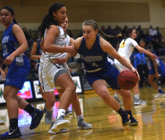 McQueen's Kendra McAninch (4) drives while taking on Bishop Manogue during their basketball game in Reno on Feb. 20, 2019.