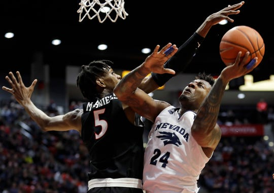 Nevada's Jordan Caroline (24) shoots against San Diego State's Jalen McDaniels on Wednesday night.