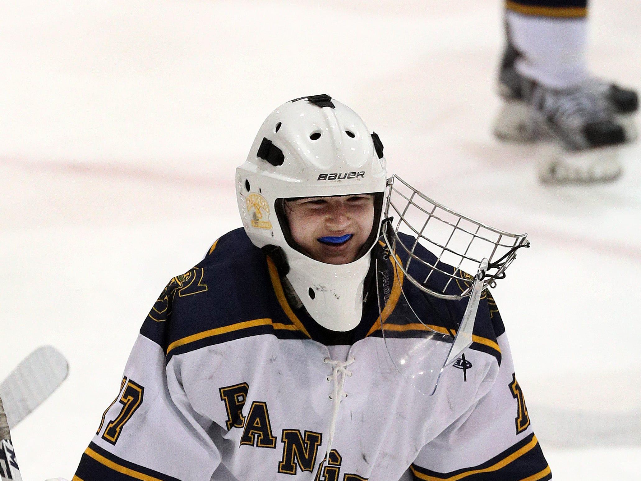 Spencerport goalie Rachel Brase's mask broke when it was hit by the puck on a shot.