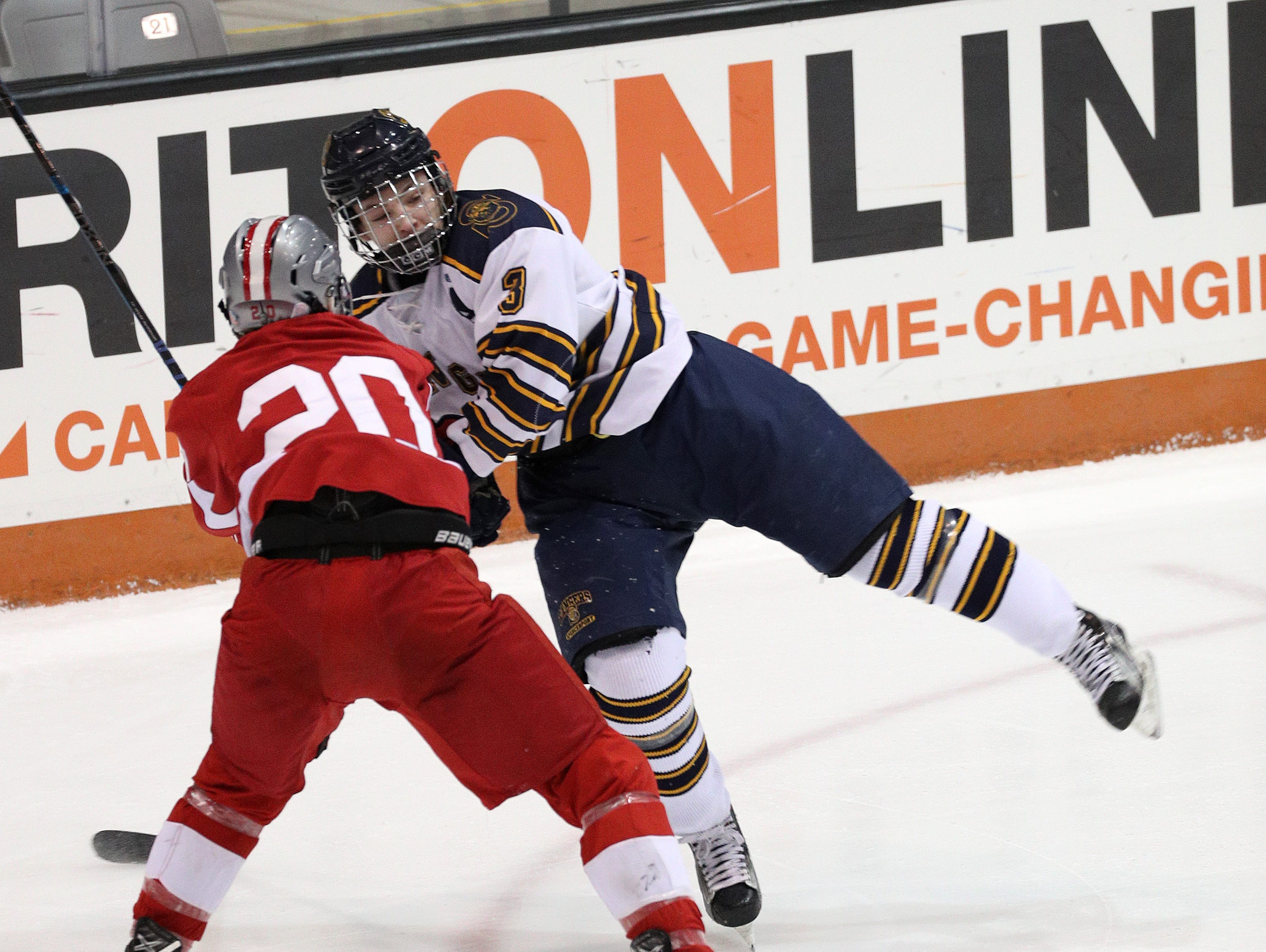 Spencerport's Luc Fedele is checked by Canandaigua's Ryan Pitka.