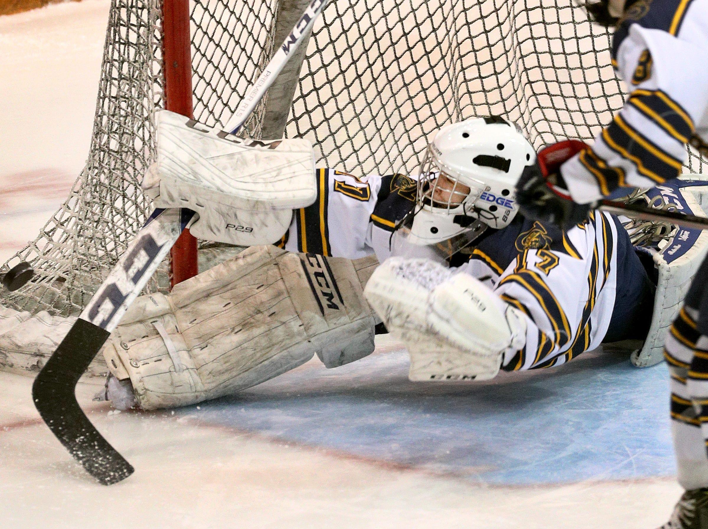 Spencerport goalie Rachel Brase makes a sprawling save against Canandaigua.