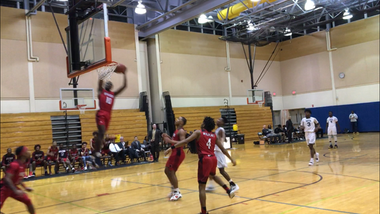Wilson's Brennan Clark goes up for the dunk