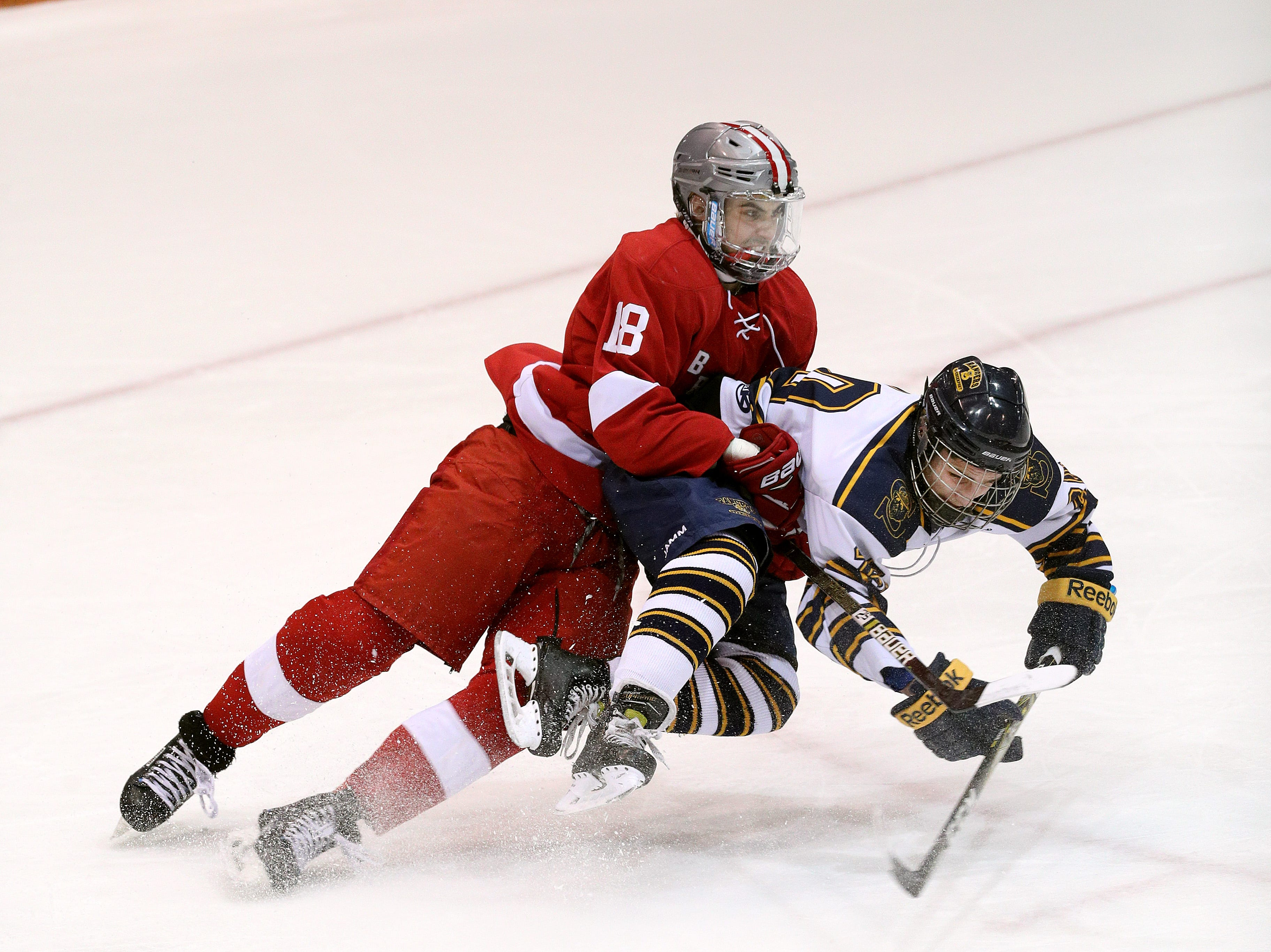 Spencerport's AJ Giannavola is taken down by Canandaigua's Michael Cichetti on a breakaway. Giannavola  missed on the ensuing penalty shot.