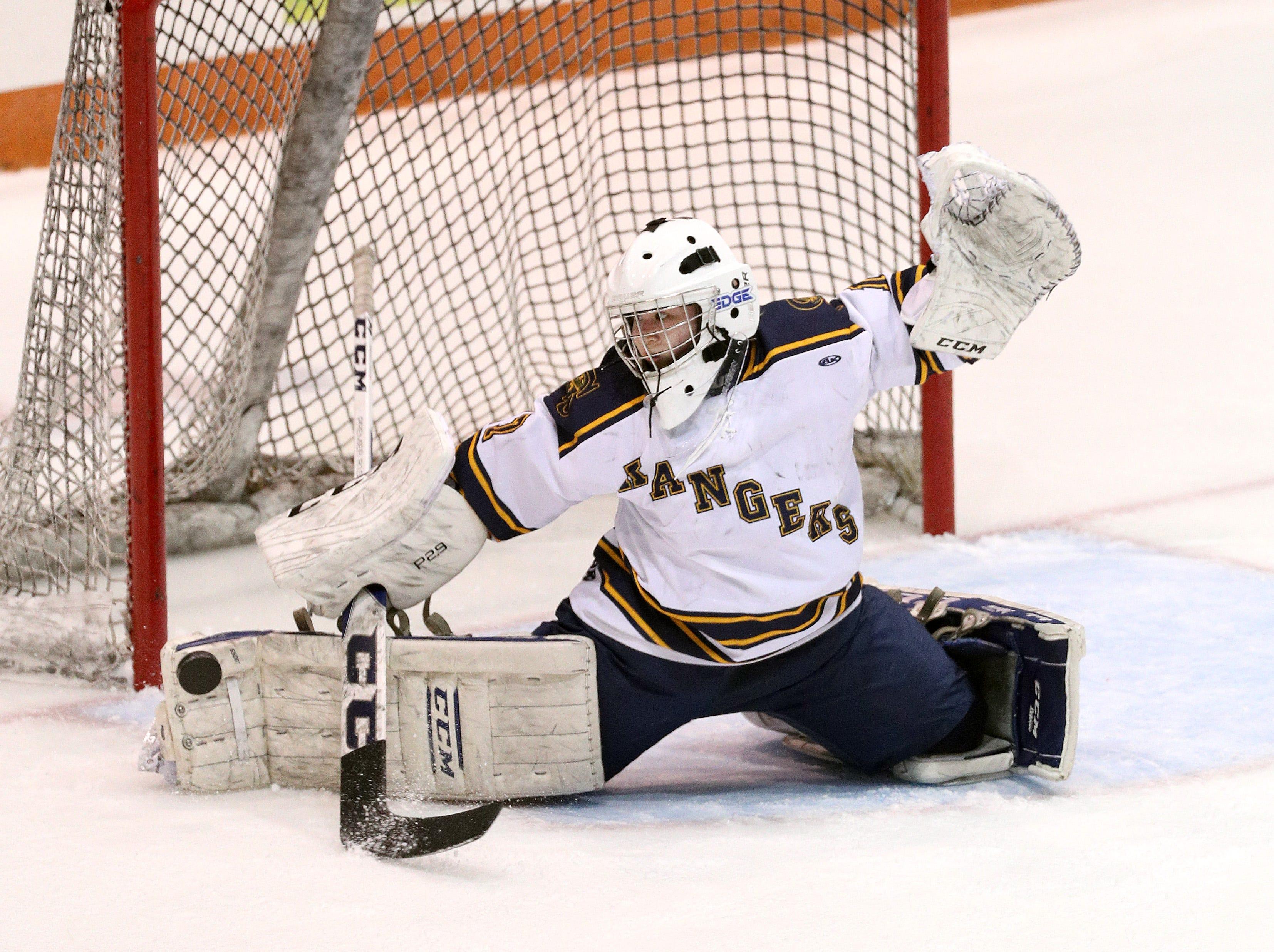 Spencerport goalie Rachel Brase makes a pas save against Canandaigua.