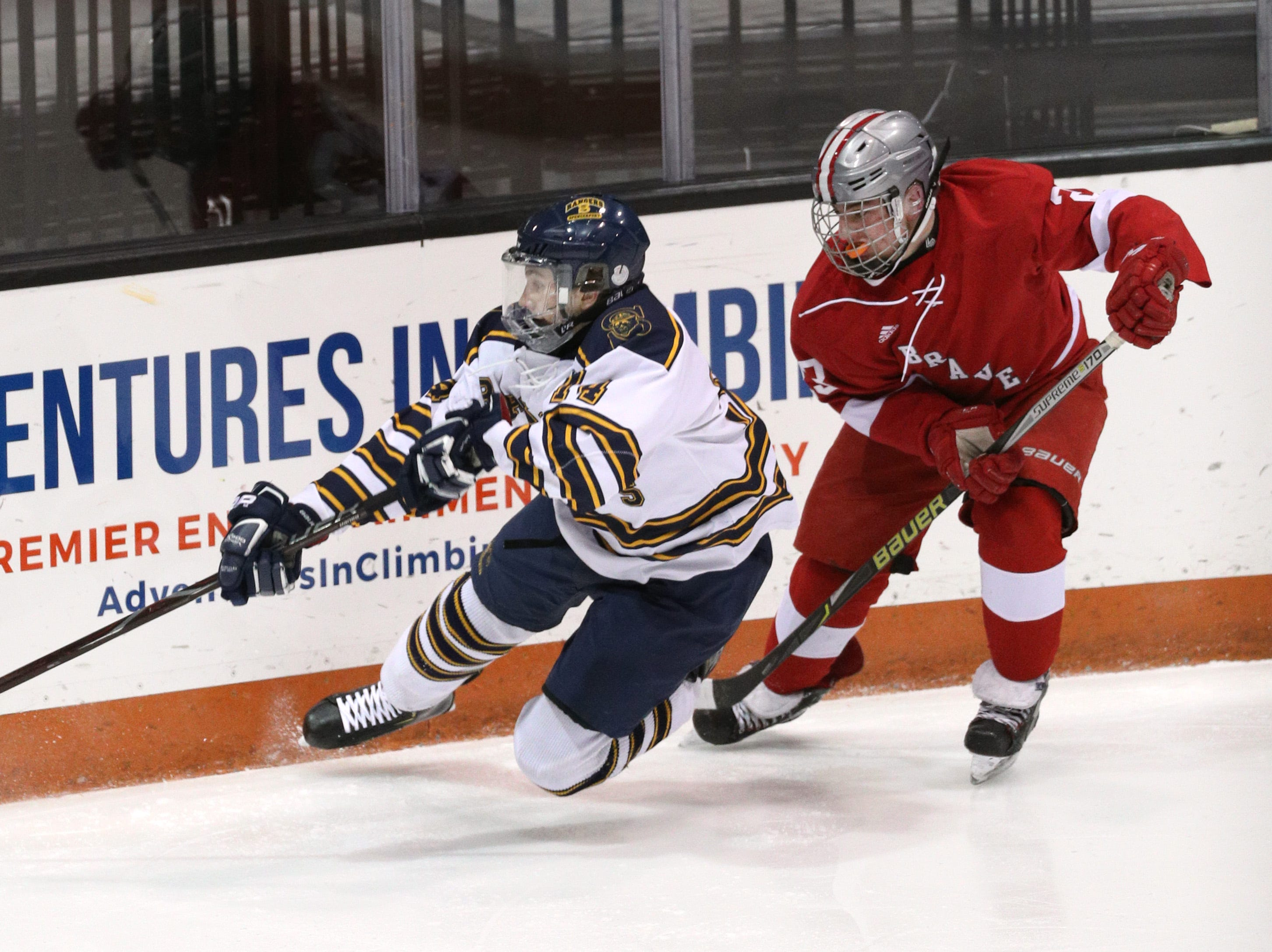 Spencerport's Mark New is tripped behind the net by Canandaigua's Anthony Holz.