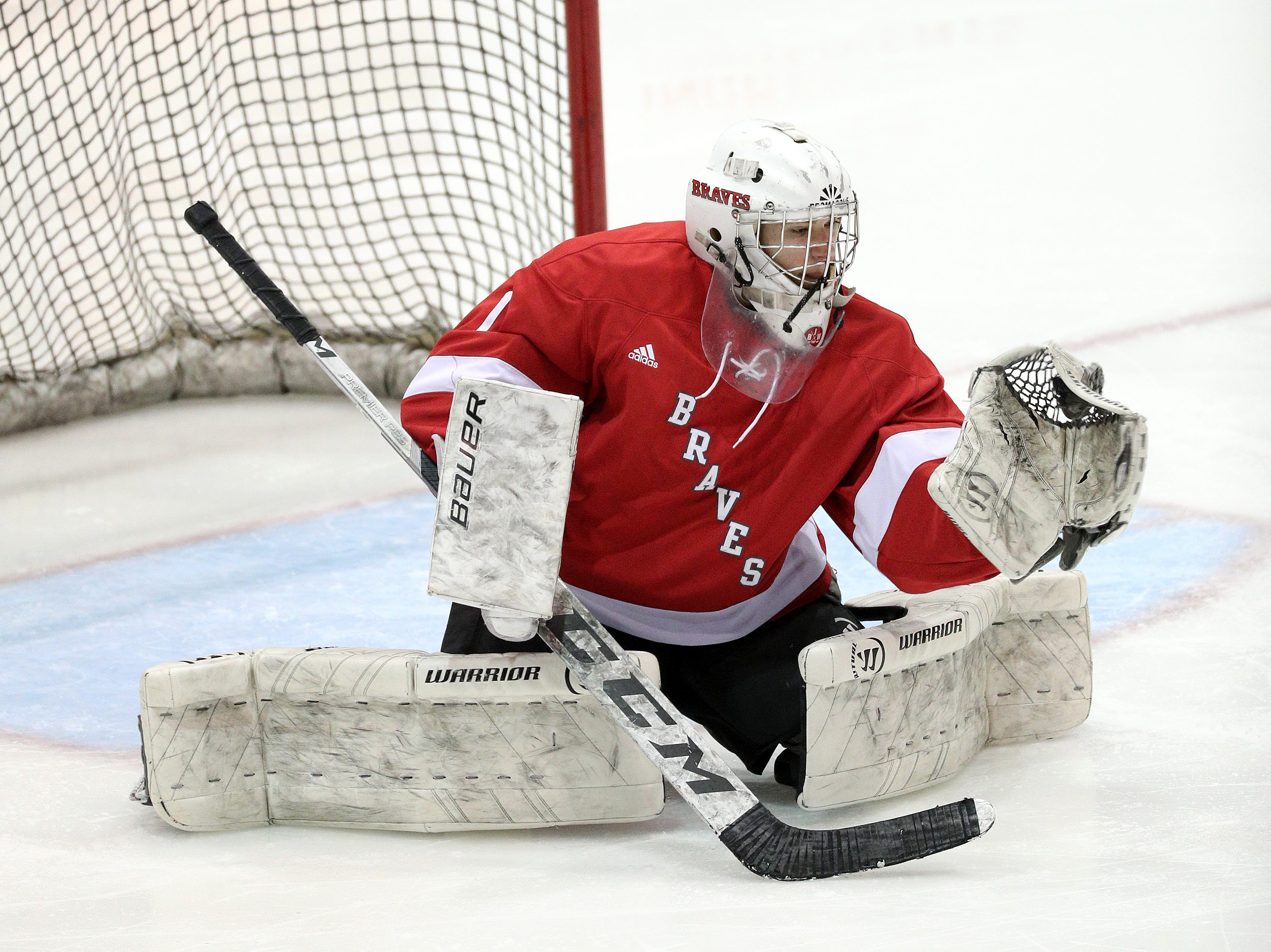 Canandaigua goalie Cade Chesler makes a glove save on this shot against Spencerport.