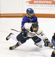 Thomas's Spencer Cade is taken down by Irondequoit's Max Letta.  Letta received a penalty on the play.