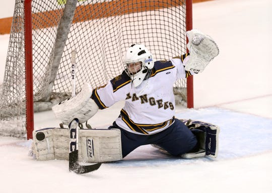 Spencerport goalie Rachel Brase makes a pad save against Canandaigua.