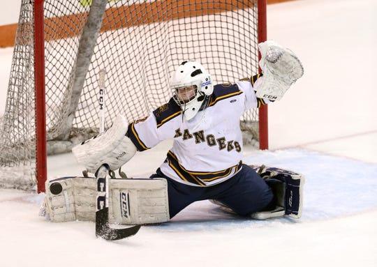 Spencerport goalie Rachel Brase makes a pad save against Canandaigua.