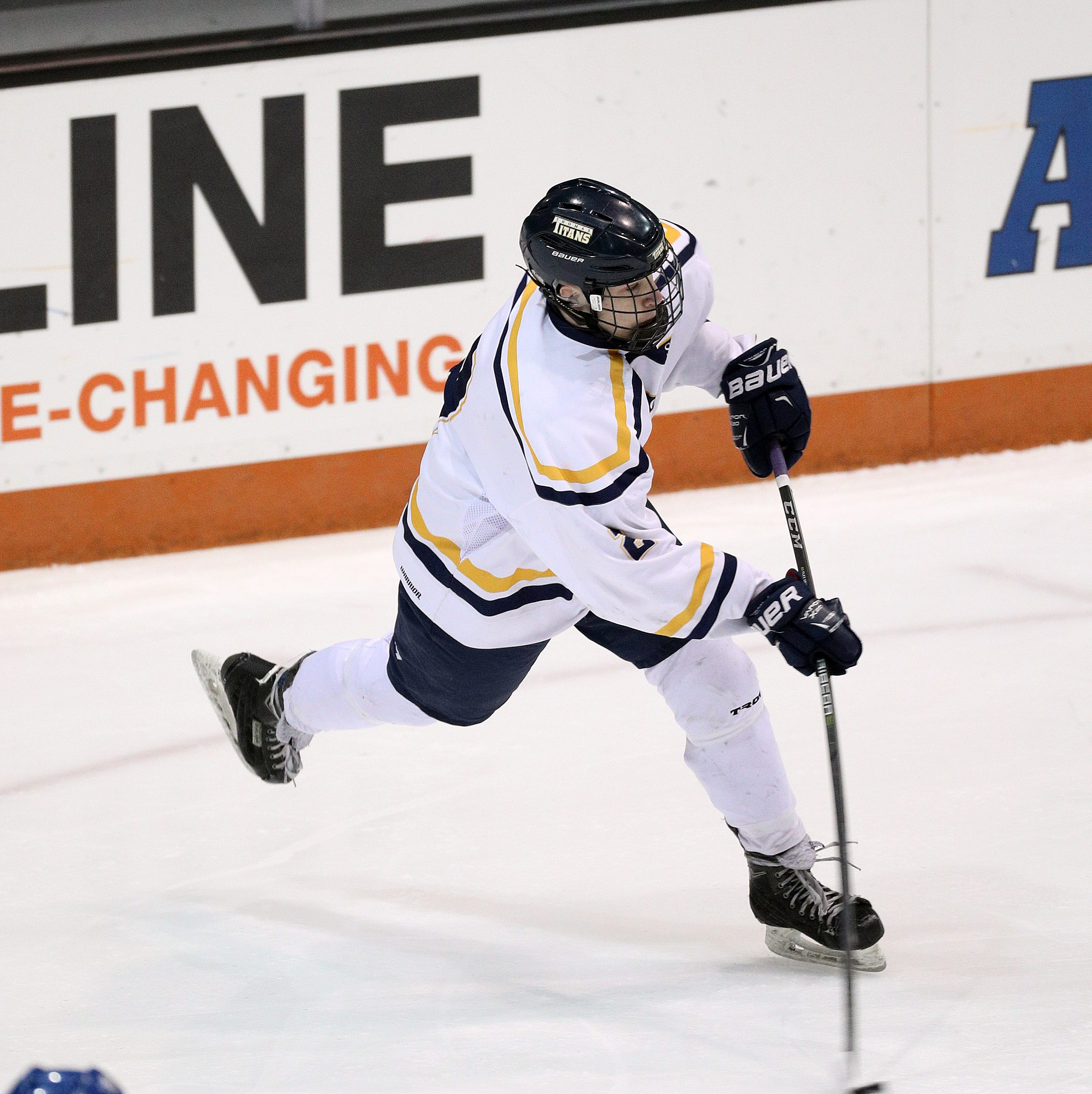 Thomas's Devin Mulcahjy gets off a wrist shot against Irondequoit in Class B semifinal game.