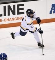 Webster Thomas's Devin Mulcahjy gets off a wrist shot against Irondequoit in Class B semifinal game.