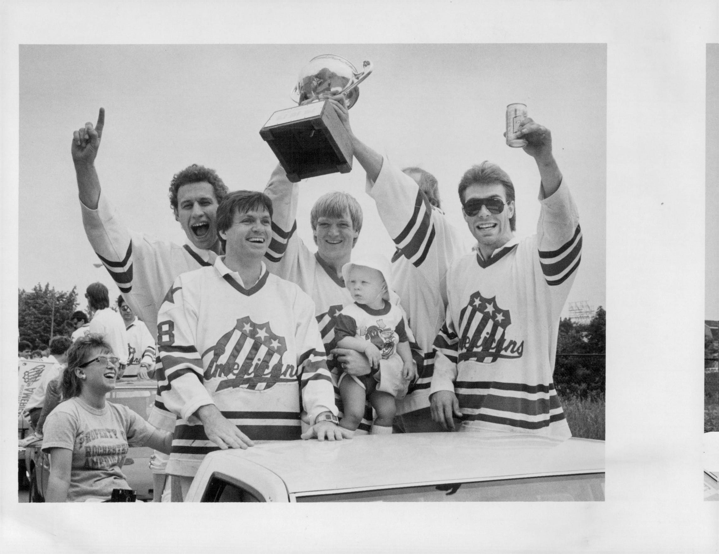 Amerks (left to right) Jack Brownschilde, Don Lever, Dave Fenyves, Andy Ristau and Warren Harper celebrate as the team parades through downtown Rochester following their Calder Cup victory in 1987.