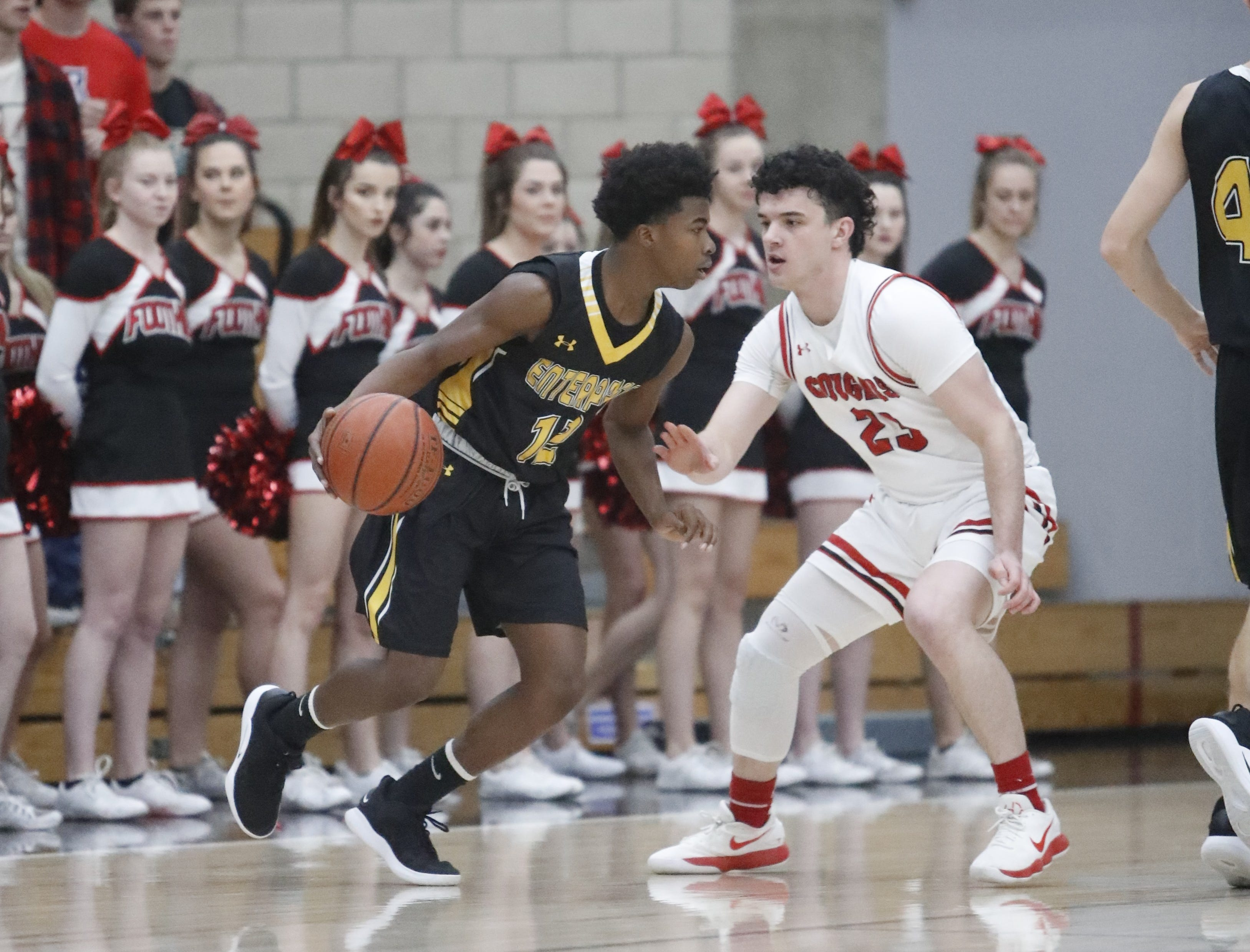 Enterprise's DeMarreya Lewis-Cooper (left) tries to get around Foothill's Chase Rossman during the Cougars' 55-50 win over the Hornets  in the Division III Northern Section semifinals on Wednesday, Feb. 20.