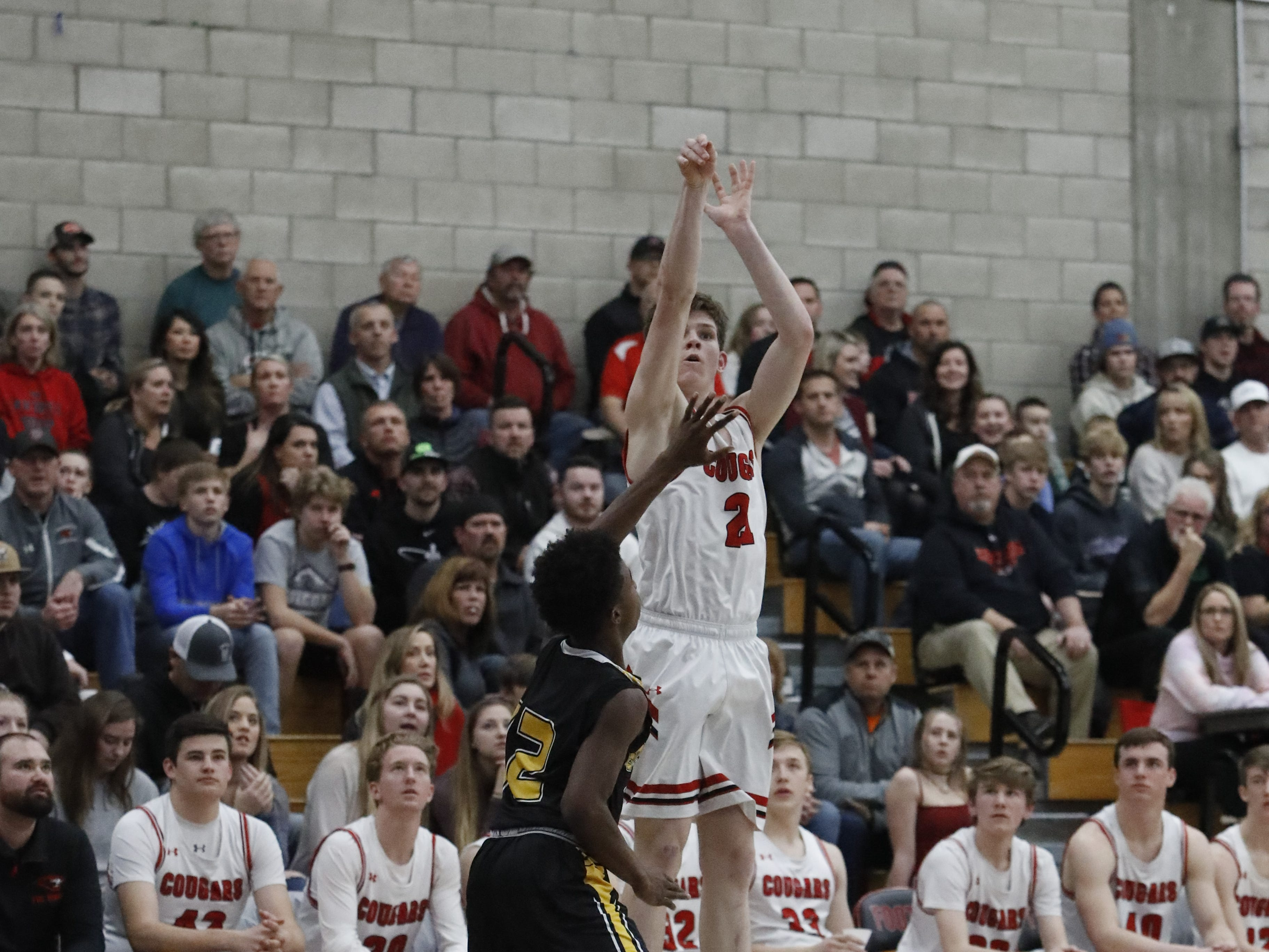Foothill's Luke Lindsey shoots a three-pointer over an Enterprise defender during the Cougars' 55-50 win over the Hornets in the Division III Northern Section semifinals on Wednesday, Feb. 20.
