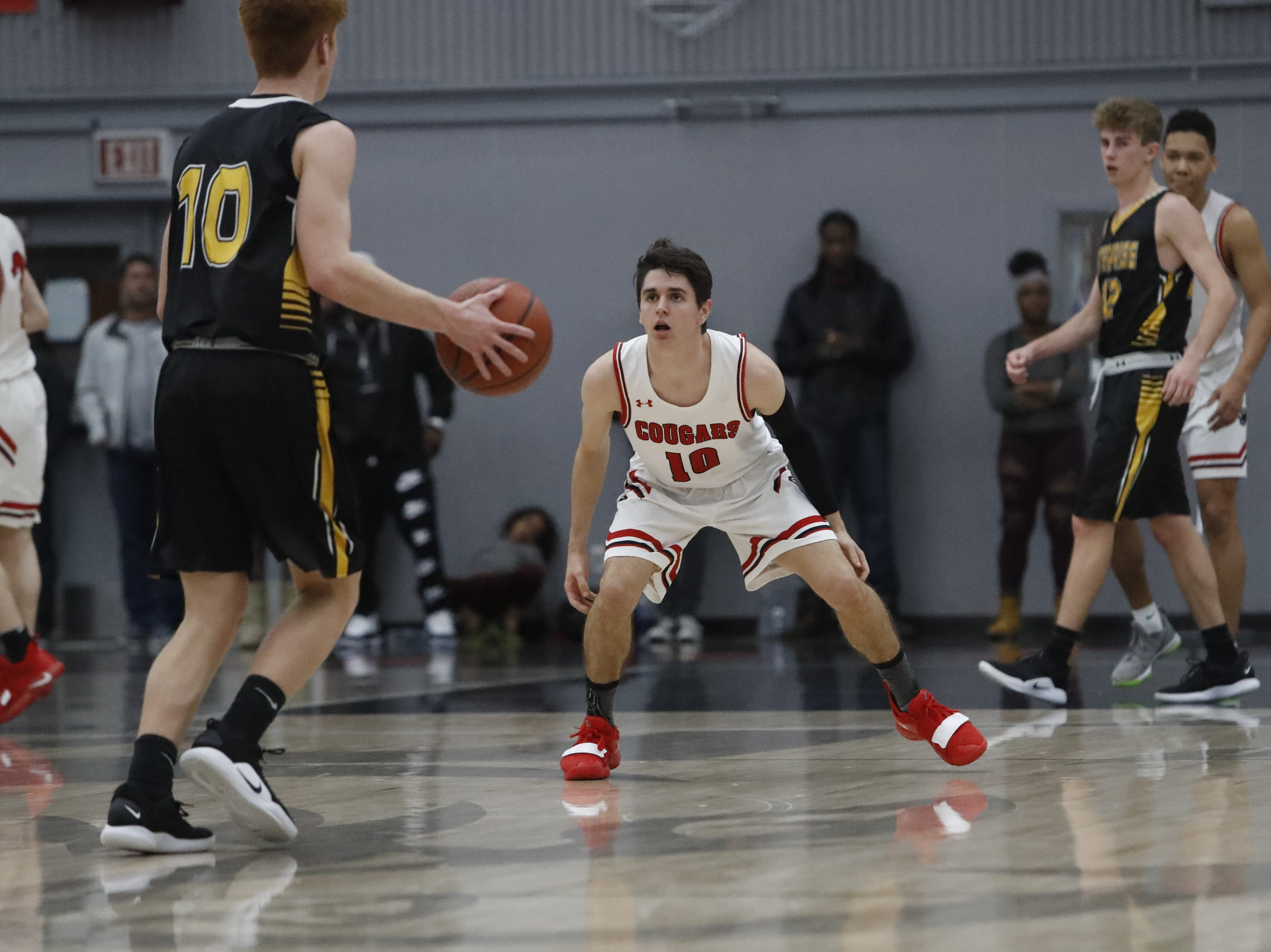 Foothill guard Josiah Palumbo (right) defends Enterprise's Adam Shoff during the Cougars' 55-50 win over the Hornets  in the Division III Northern Section semifinals on Wednesday, Feb. 20.