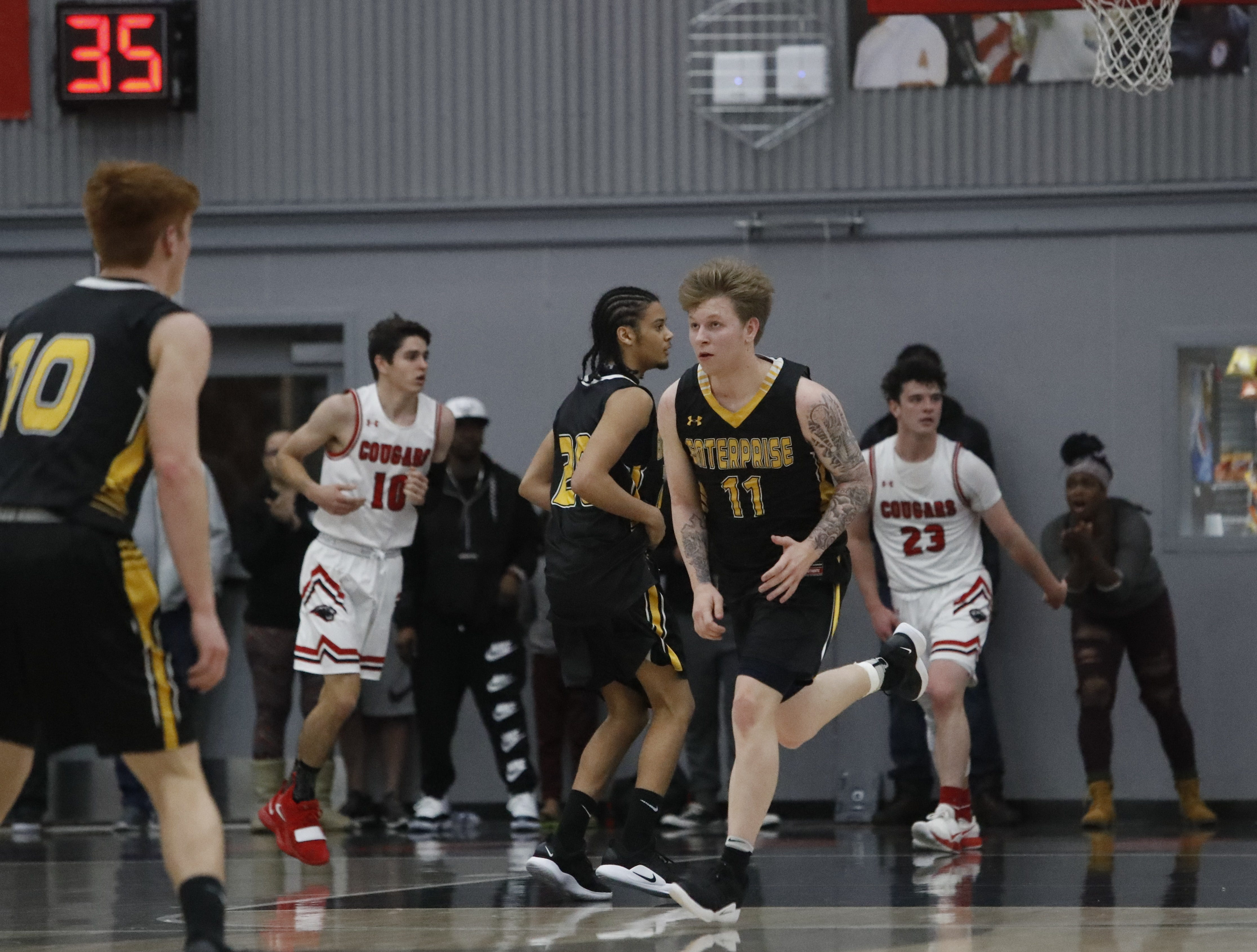 Enterprise guard Ryder O'Banion jogs back on defense after making a layup against Foothill during the Cougars' 55-50 win over the Hornets in the Division III Northern Section semifinals on Wednesday, Feb. 20.