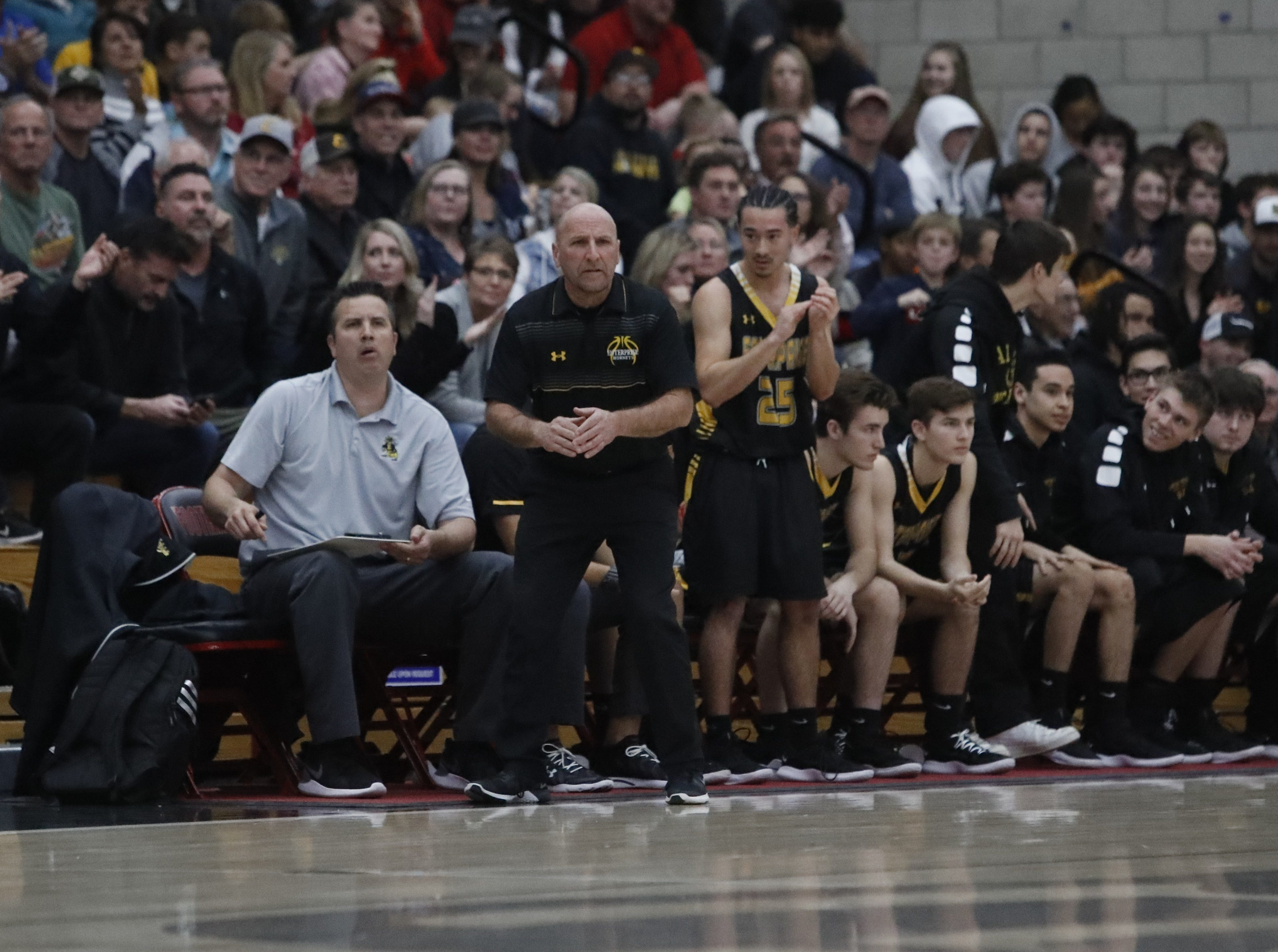 Enterprise coach Jim Deaver motions for a timeout during the Cougars' 55-50 win over the Hornets in the Division III Northern Section semifinals on Wednesday, Feb. 20.