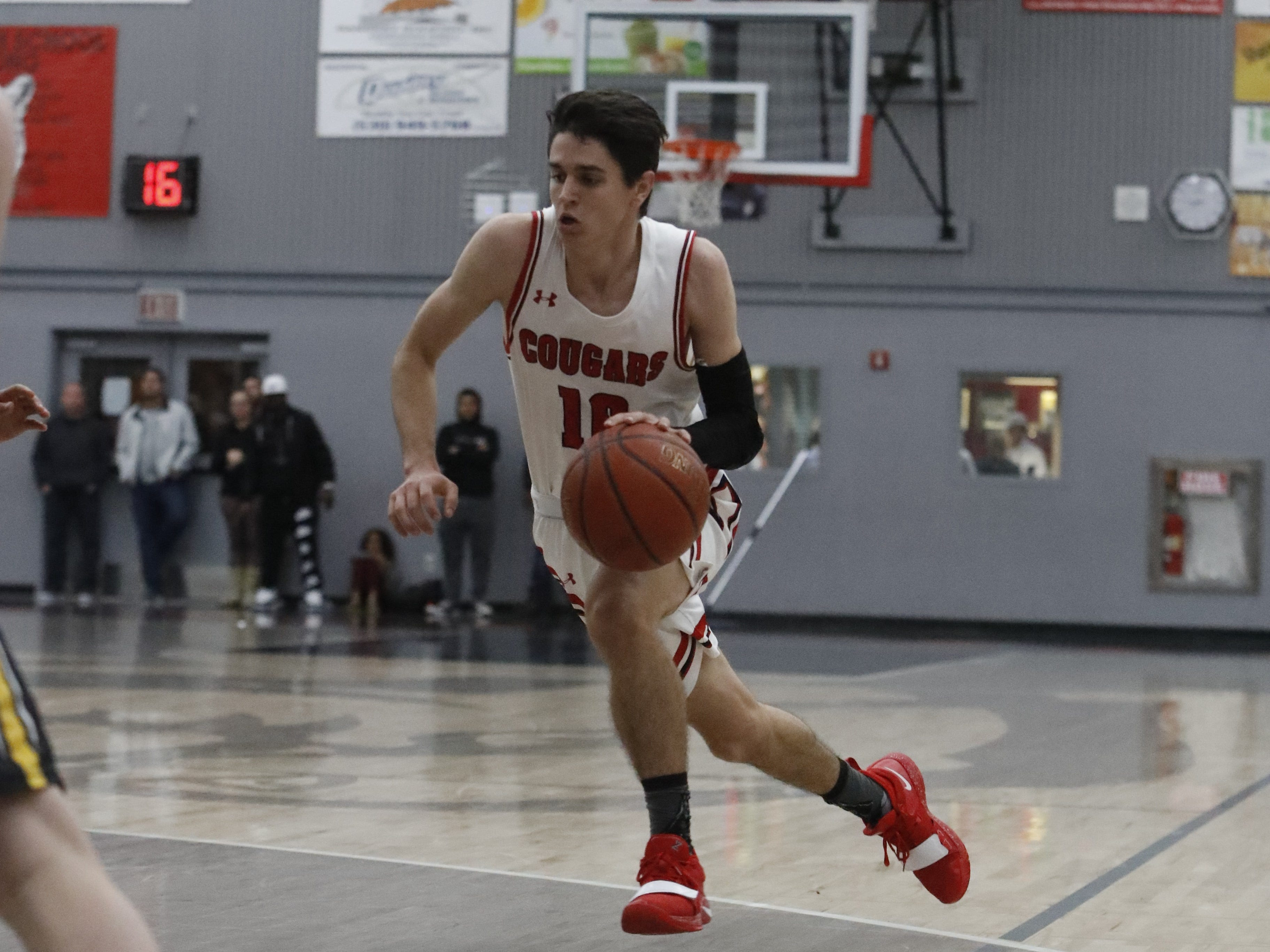 Foothill guard Josiah Palumbo drives to the rim during the Cougars' 55-50 win over the Hornets in the Division III Northern Section semifinals on Wednesday, Feb. 20.