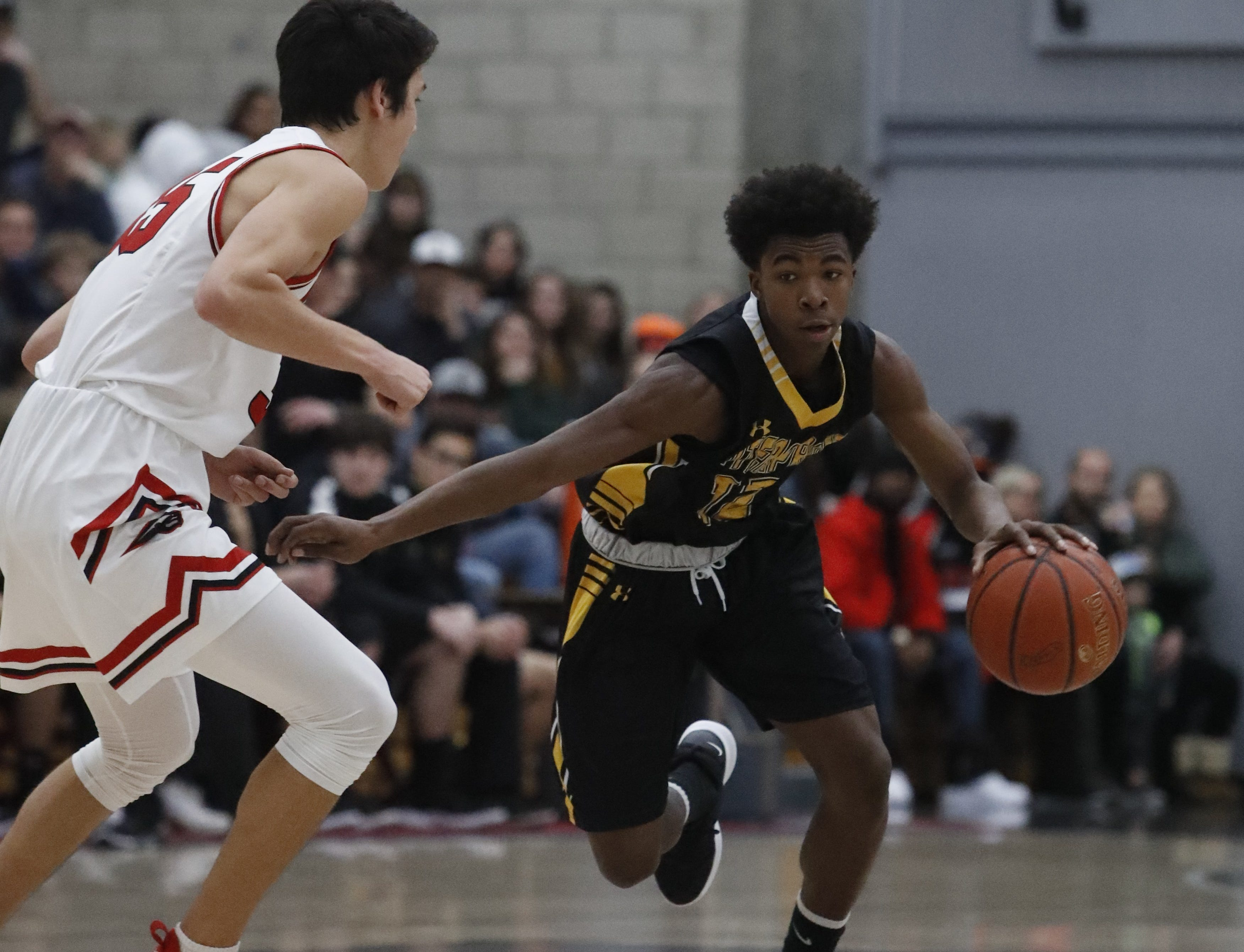 Enterprise freshman DeMarreya Lewis-Cooper tries to dribble around Foothill's Bekdoo Lewis during the Cougars' 55-50 win over the Hornets  in the Division III Northern Section semifinals on Wednesday, Feb. 20.