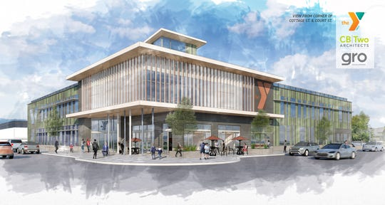 Huge expanses of windows and glass, from sidewalk to roof on much of the facade, are prominent in the design of the new YMCA planned for the corner of Court and Cottage streets NE.