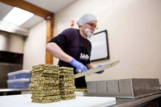 Kitchen manager Aldo Arevalo prepares raspberry kale maca-flavored LivBar energy bars before they are packaged in downtown Salem on Wednesday, Feb. 20, 2019.