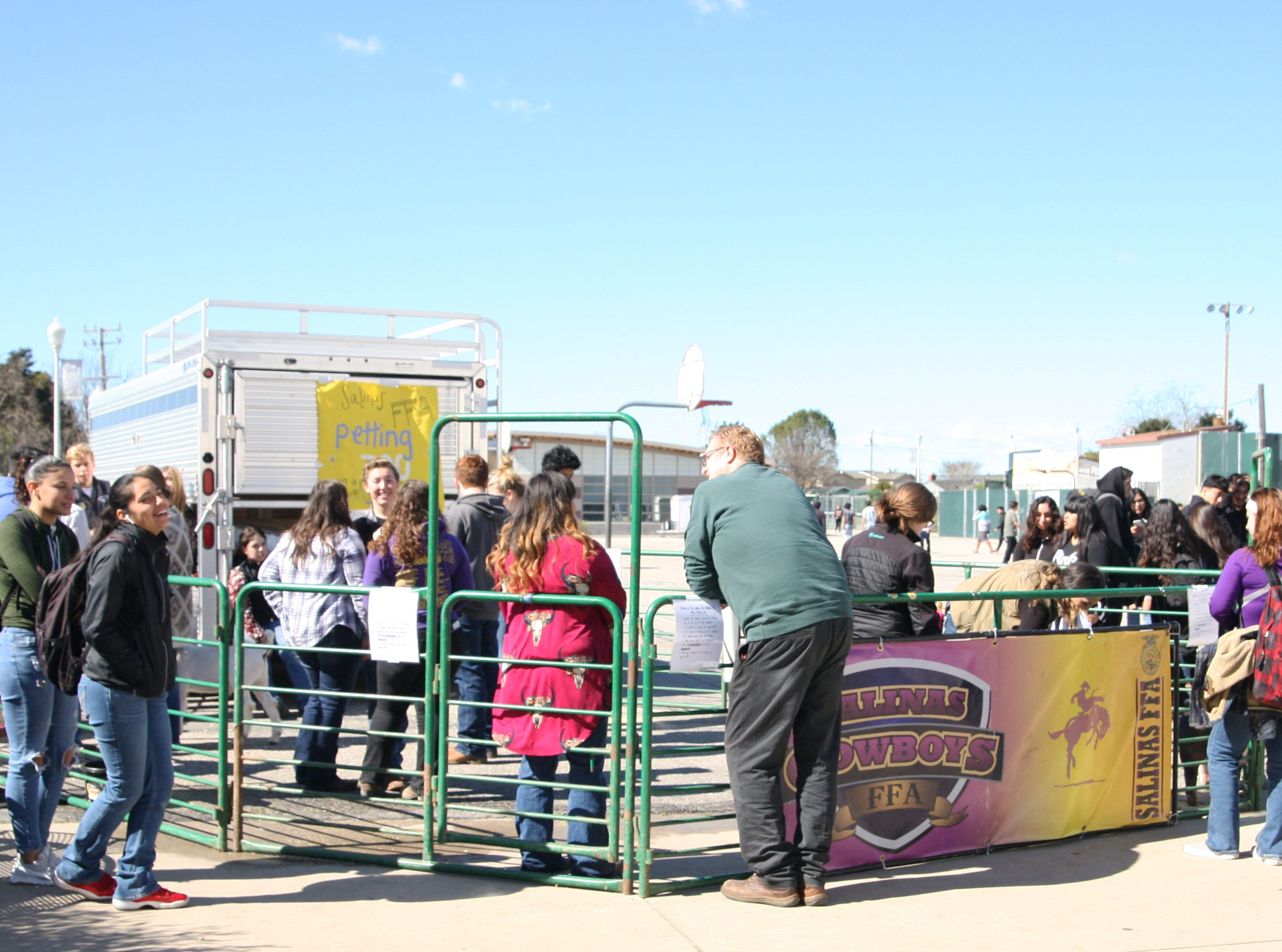 Students and teachers gather around the annual petting zoo put on by the FFA at Salinas High.