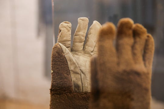 Sealskin gloves patterned in 1876 on display as part of the Douglas McChristian Collection at Fort Concho.