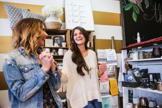Abby Long and Jennifer Biggs laugh as they walk around the gifts area Thursday, Feb. 21, 2019, at The Roost Boutique, 3560 Knickerbocker Road.