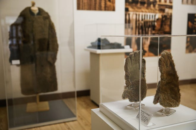 Fur coats and gloves on display as part of the Douglas McChristian Collection at Fort Concho.