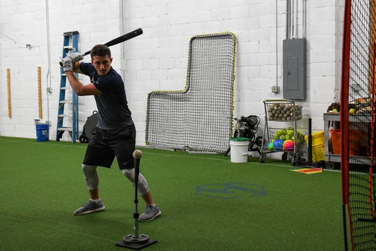 Sussex Tech Senior Braydan Graham practices hitting at the Athlete Academy in Salisbury on Wednesday, Feb. 20, 2019.