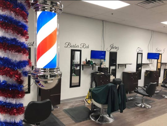 In addition to offering hair cuts, Rich Mitchell hopes that his Oshkosh and Appleton barbershops can help bring people together.